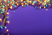 Christmas lights on dark blue background with copy space. Decora — Stock fotografie