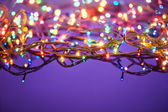 Christmas lights on dark blue background with copy space. Decora — Stock Photo