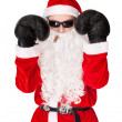 Santa Claus wearing sunglasses with boxing glove smoking a cigar — Stock Photo