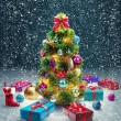 Royalty-Free Stock Photo: Christmas tree and gift box on snow