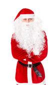 Porträtt av jultomten står med händerna vikas mot isola — Stockfoto