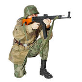 Soldier with submachine gun. Isolated on white background — Stock Photo