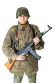 Soldier with submachine gun isolated — Stock Photo