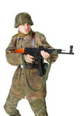 Soldier shoots submachine gun — Stock Photo