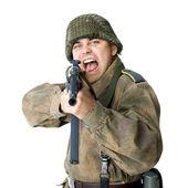 Soldier shoots submachine gun — Stock Photo