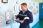 Portrait of young engineer at control room — Stock Photo