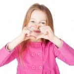 Llittle girl showing heart symbol — Stock Photo