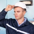 Young engineer in control room — Stock Photo
