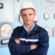 Stock Photo: Portrait of young engineer at control room