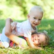 Brother and sister playing on grass — Stock Photo