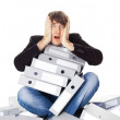 Tired man is sitting with many paper folders isolated on white b — Stock Photo