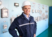 Young engineer at control room — Stock Photo