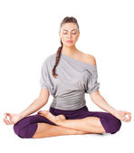 Genç kadın meditasyon lotus poz — Stok fotoğraf