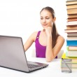 Student girl working on a laptop — Stock Photo