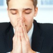 Portrait of praying young businessman — Stock Photo #30754339