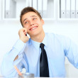 Young laughing businessman talking on cell phone — Stock Photo #30754395