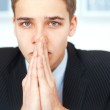 Portrait of praying young businessman — Stock Photo #30754855