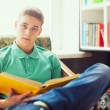 Student reading book at home — Stock Photo