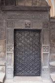 Old black metallic door — Stock Photo