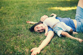 Mother and son having fun on the grass — Stock Photo