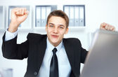 Young businessman celebrating his success — Stock Photo