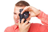 Young photographer taking pictures with his camera — Stockfoto