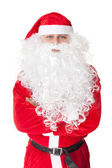 Santa Claus standing with hands folded against — Stock Photo