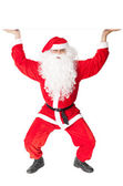 Santa Claus holding something over head — Stock Photo
