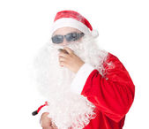 Santa Claus wearing sunglasses and smoking a cigar — Stock Photo
