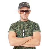 Young army soldier wearing sunglasses — Stock Photo