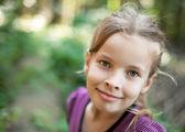 Smiling cute little girl — Stock Photo