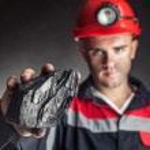 ������, ������: Coal miner showing lump of coal