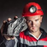 Постер, плакат: Coal miner showing lump of coal