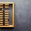 Accounting abacus on gray textured background — Stock Photo
