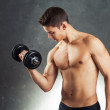 Bodybuilder man exercising with dumbbell — Stock Photo