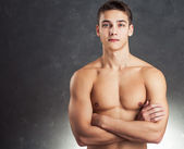 Portrait of muscular young man — Stock Photo