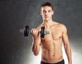 Bodybuilder man exercising with dumbbell — Fotografia Stock