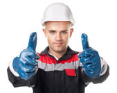Worker in protective gloves giving thumb up — Stock Photo