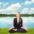 Young business woman meditating — Stock Photo