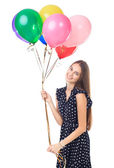 Happy woman with colorful balloons — Stock Photo