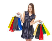 Woman with colorful shopping bags — Stock Photo