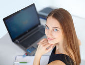 Beautiful young business woman in office — ストック写真