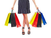 Belden aşağı görünümü olan kadın alışveriş torbaları — Stok fotoğraf