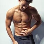 ������, ������: Muscular man whis abdominal pain