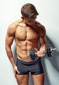 Young bodybuilder man exercising — Stock Photo