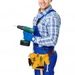 Young construction worker with electric drill — Stock Photo #47063617