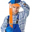 Young construction worker with spirit level — Stock Photo #47063789