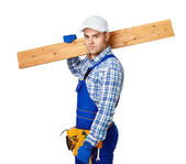 Young carpenter whis wooden plank — Foto Stock