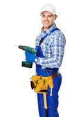 Young construction worker with electric drill — Stock Photo