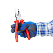 Pliers in hand — Stock Photo